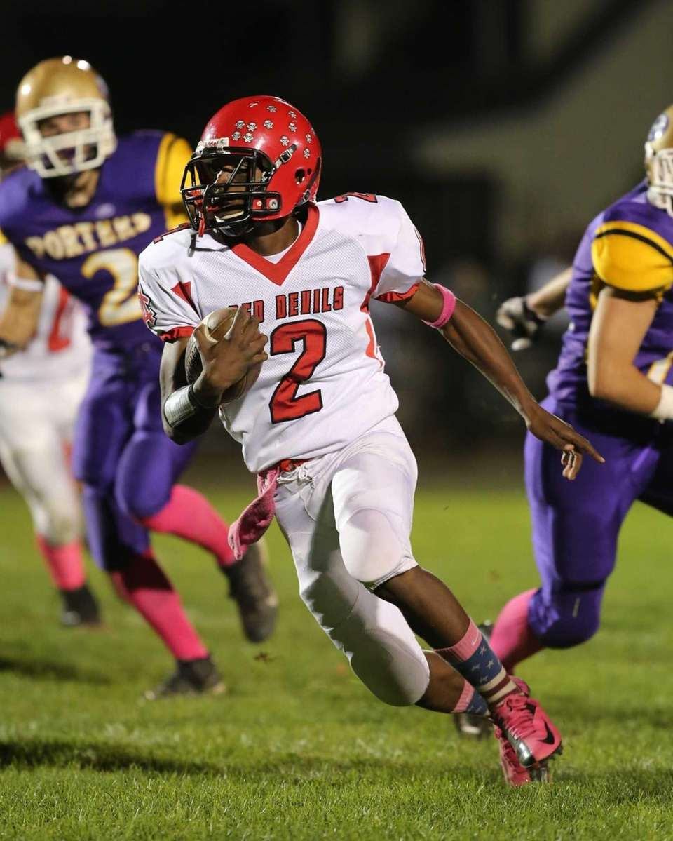 Center Moriches' Tarik Rountree returns a punt in