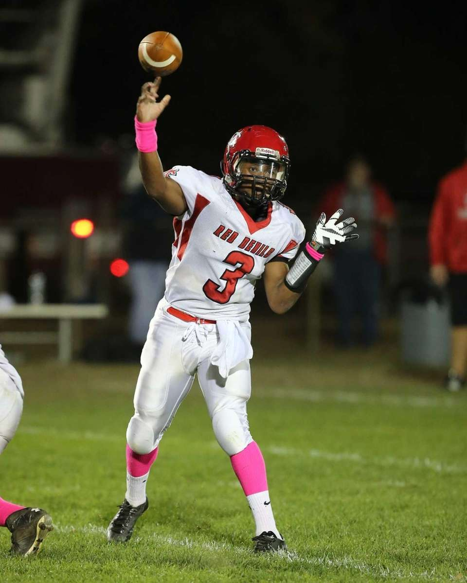 Center Moriches Quarterback Tyrell Thomas throws a first