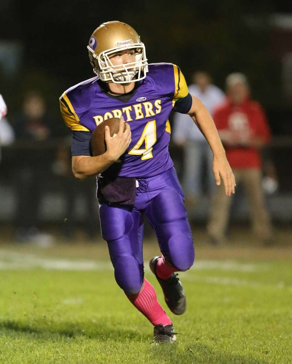 Greenport/Southold quarterback Matt Drinkwater keeps the ball for
