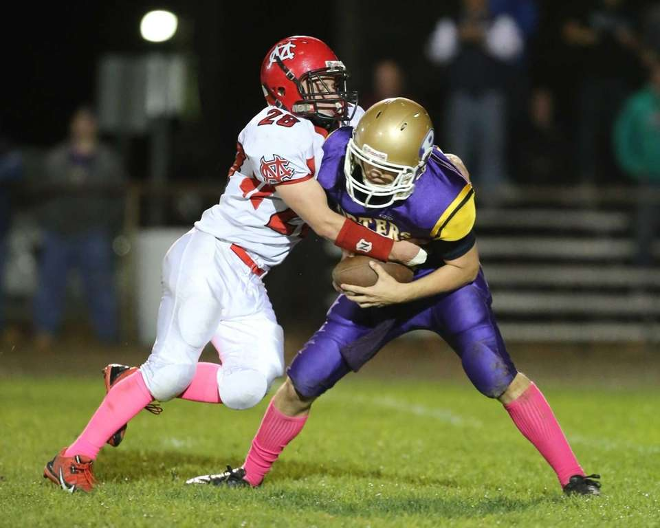 Greenport/Southold Quaterback Matt Drinkwater is sacked in the