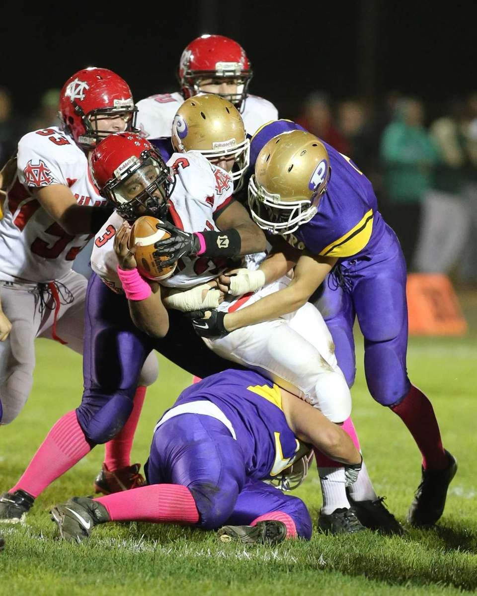 Center Moriches Quarterback Tyrell Thomas fights for a