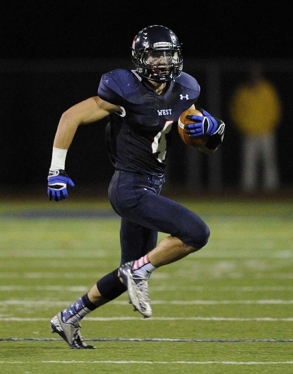 Smithtown West's Kyle A. Mathie runs the football