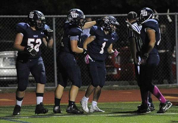 Smithtown West's Andrew Lapreziosa is congratulated by his