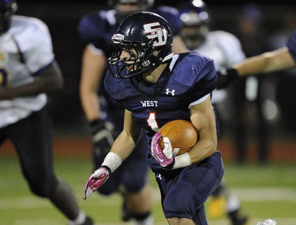 Smithtown West's Andrew Lapreziosa runs the football against