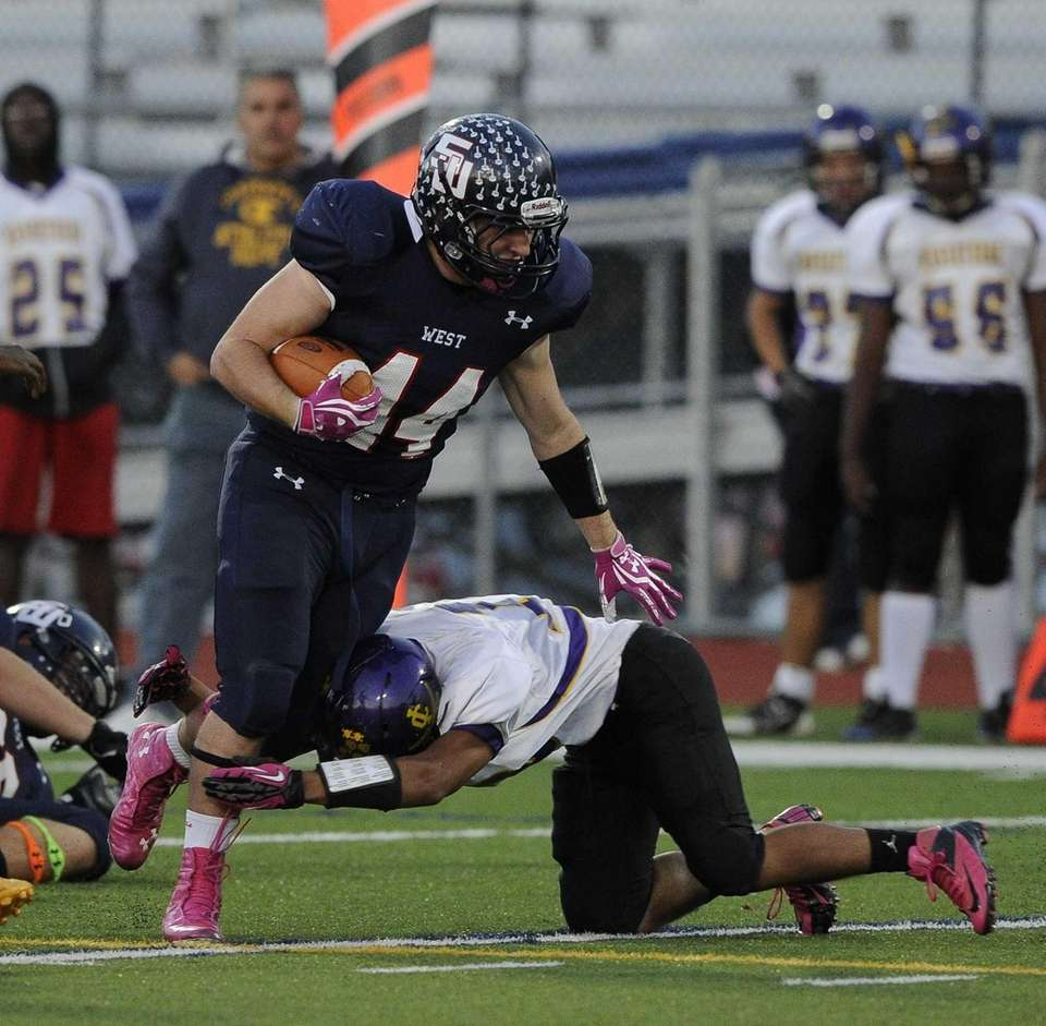Smithtown West's Logan Greco is tackled by Central