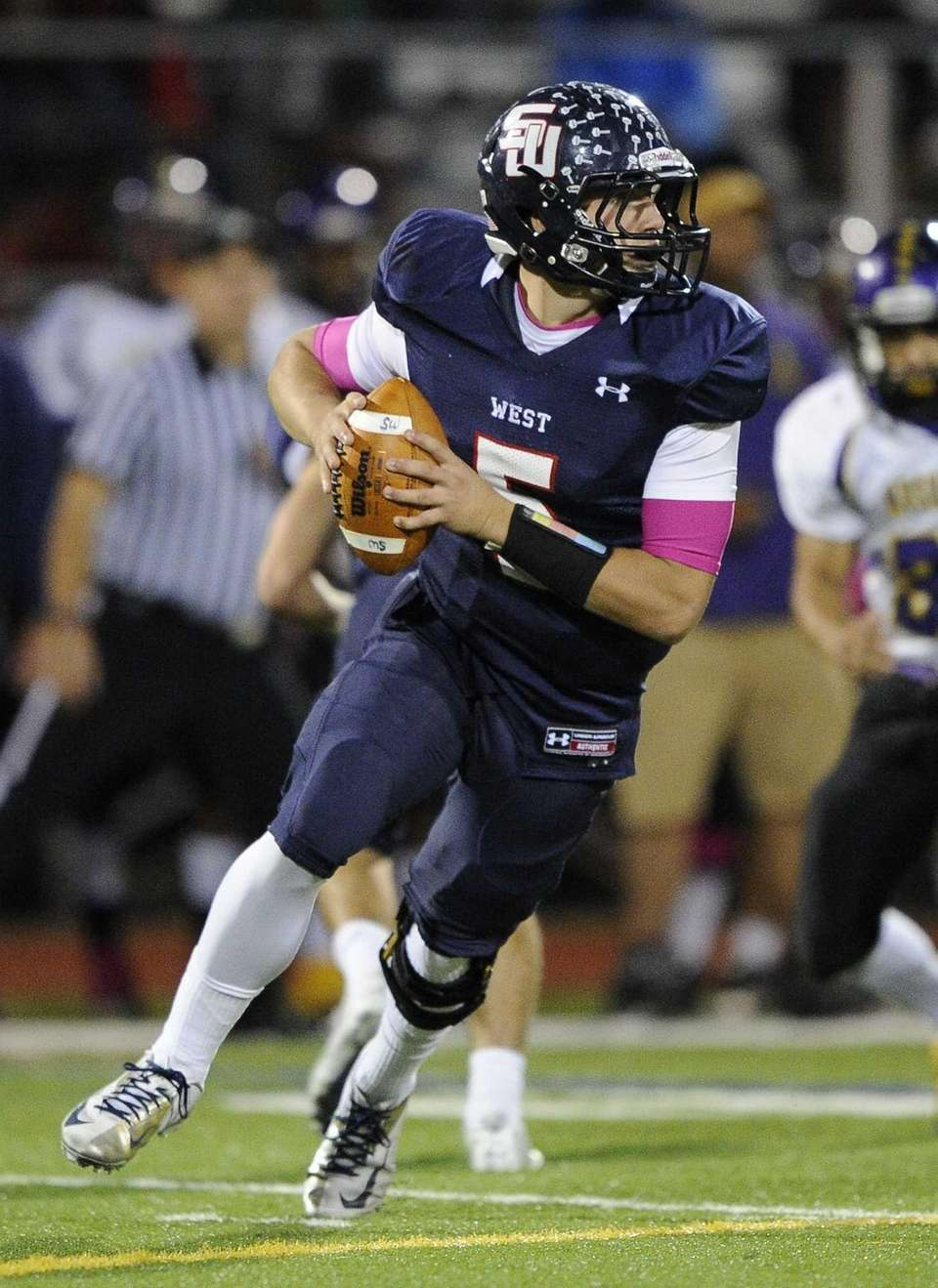 Smithtown West Matthew Heldberg Jr. drops back to