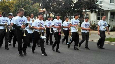 The Sewanhaka High School marching band walks through