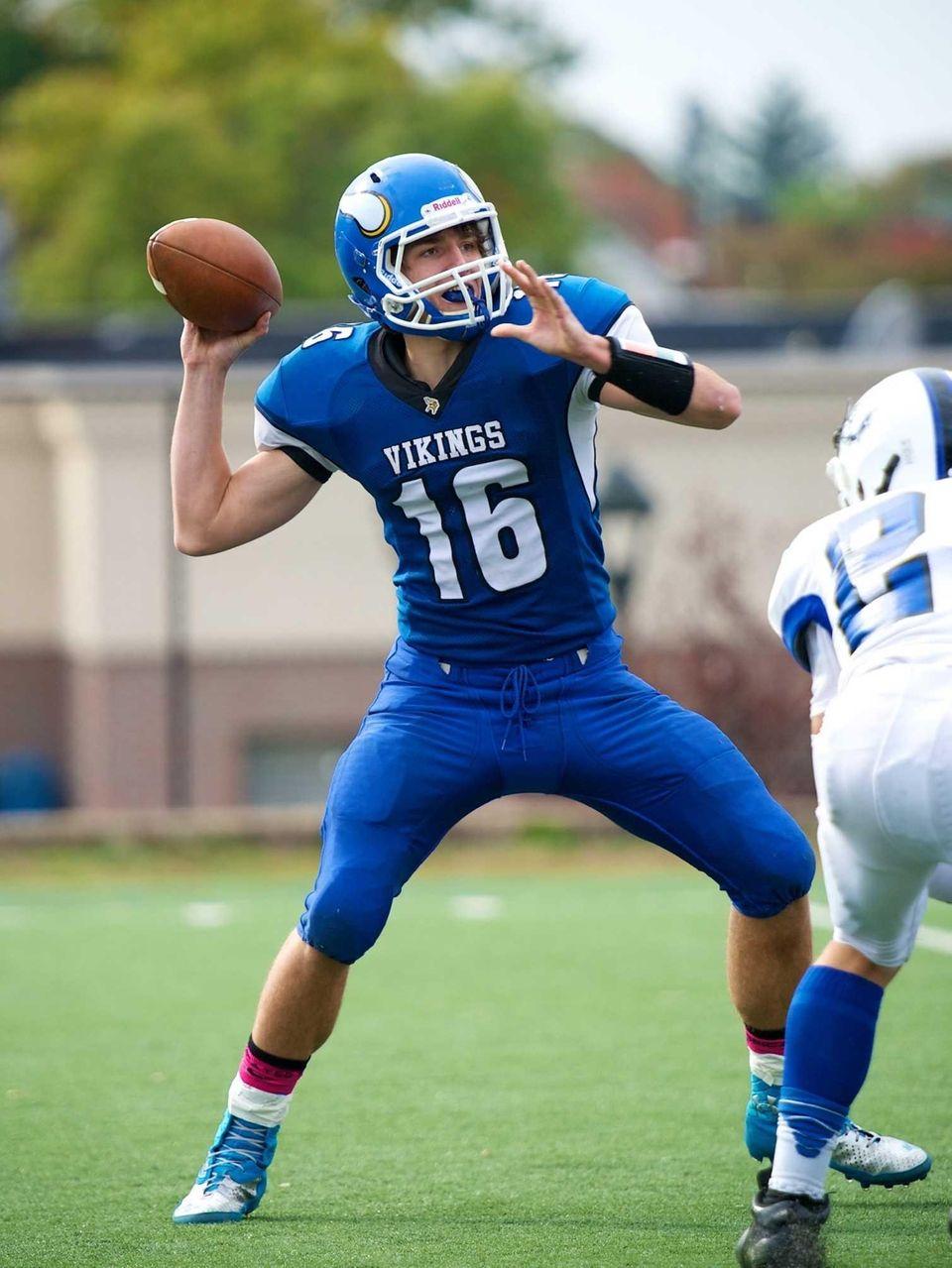 Port Washington quarterback QB James Burns attempts a