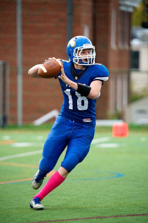 Port Washington quarterback Matthew Nicholson attempts a pass