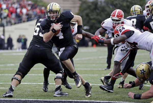 Vanderbilt quarterback Patton Robinette (no. 4) scores a