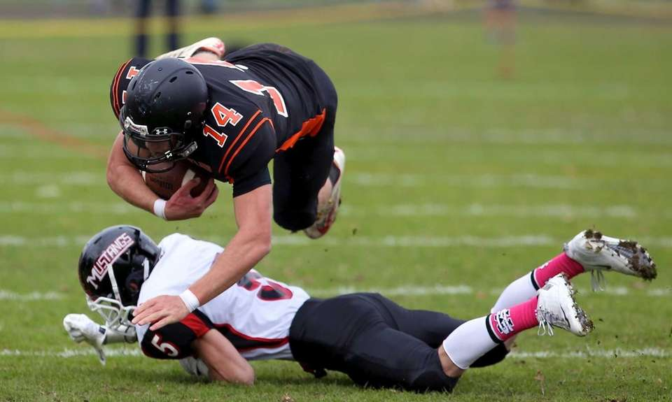 Babylon WR Jake Carlock dives over Mt. Sinai