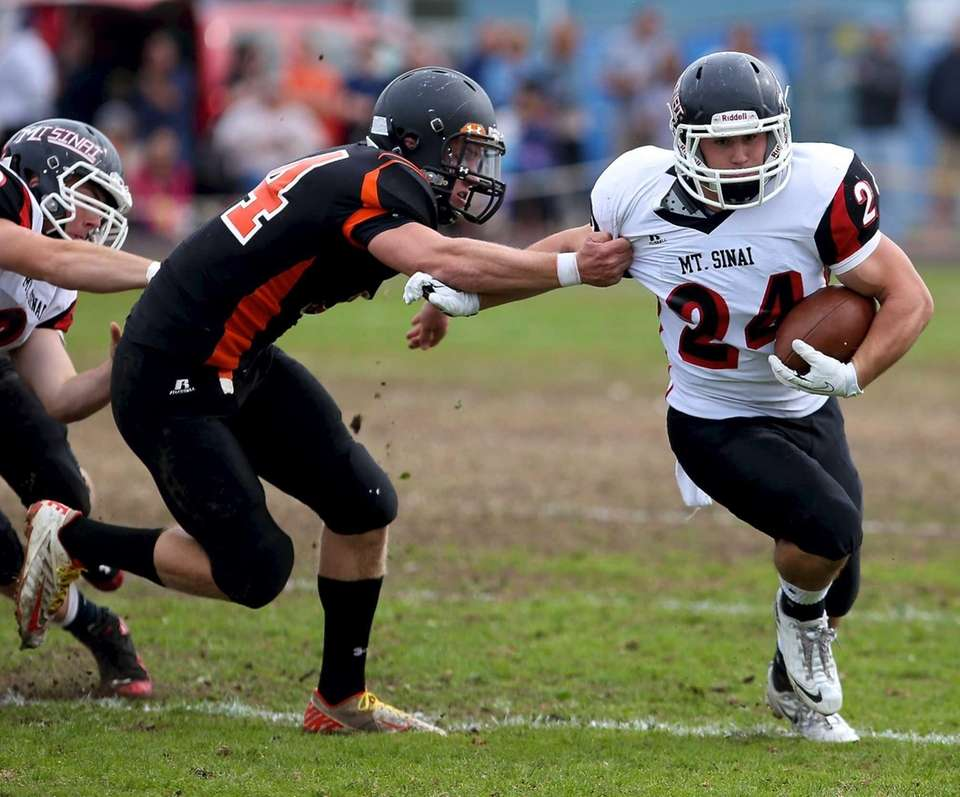 Mt. Sinai RB Mike Cortese tries to break