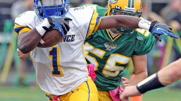 Lawrence's Jordan Fredericks runs for yardage against Lynbrook.