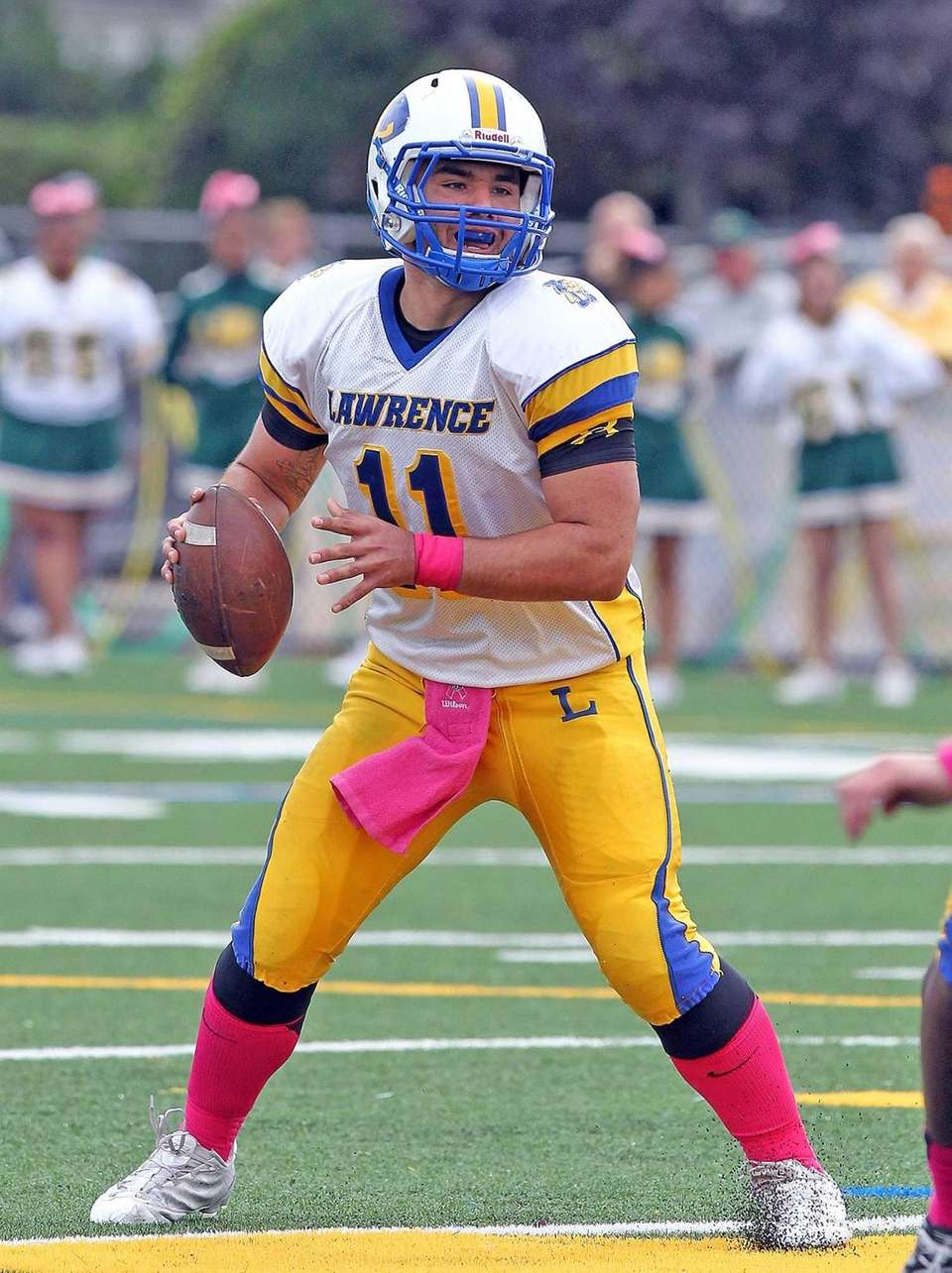 Lawrence's QB Joe Capobianco looks over the middle
