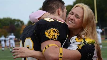 Terry Catalano, 47, hugs her son, Stephen, a