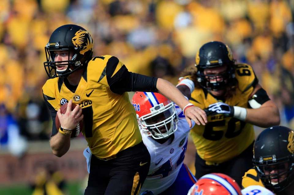 Missouri quarterback Maty Mauk (no. 7) carries the