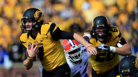 Missouri quarterback Maty Mauk (no. 7) carries the