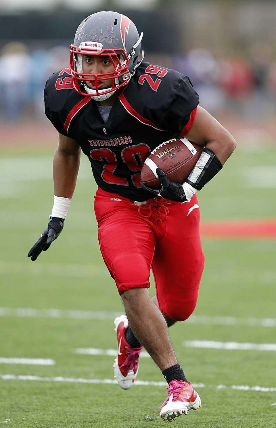 Connetquot's Bryan Ramirez rushes during the first half