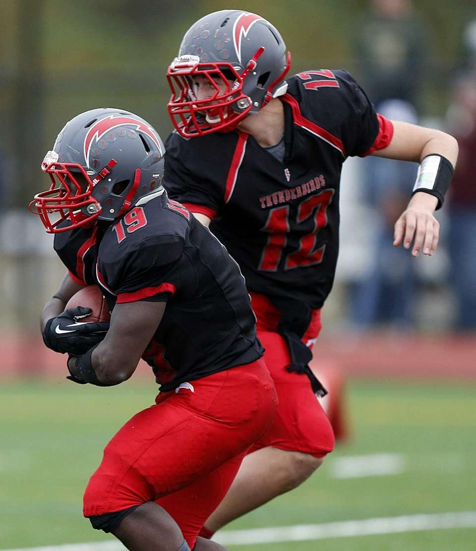 Connetquot quarterback Ricky Hahn (no. 12) hands off