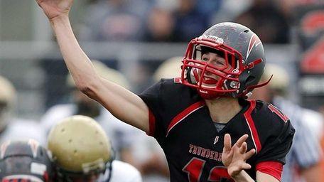 Connetquot quarterback Ricky Hahn (no. 12) passes during