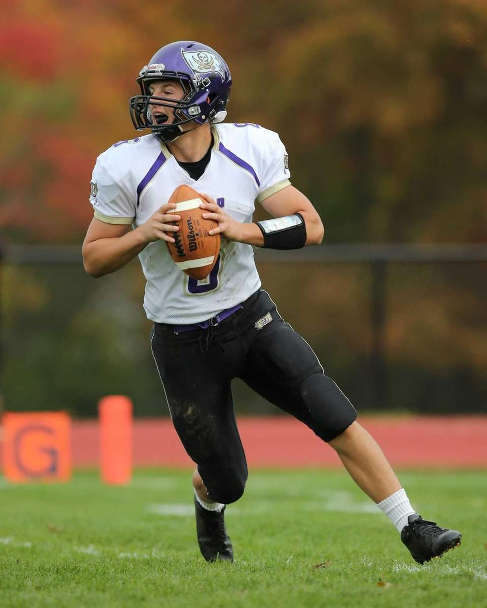 Islip quarterback Kieran Mullins looks to pass against