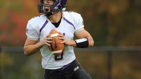 Islip quarterback Kieran Mullins looks to pass against