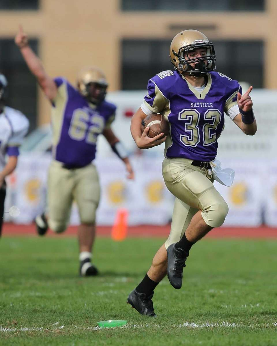 Sayville returner Matthew Selts (no. 32) returns the