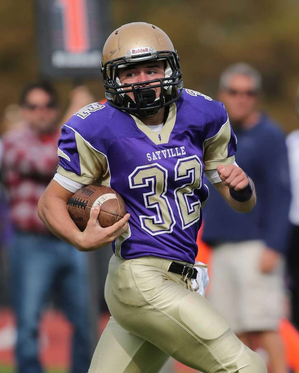 Sayville returner Matthew Selts returns the opening kickoff