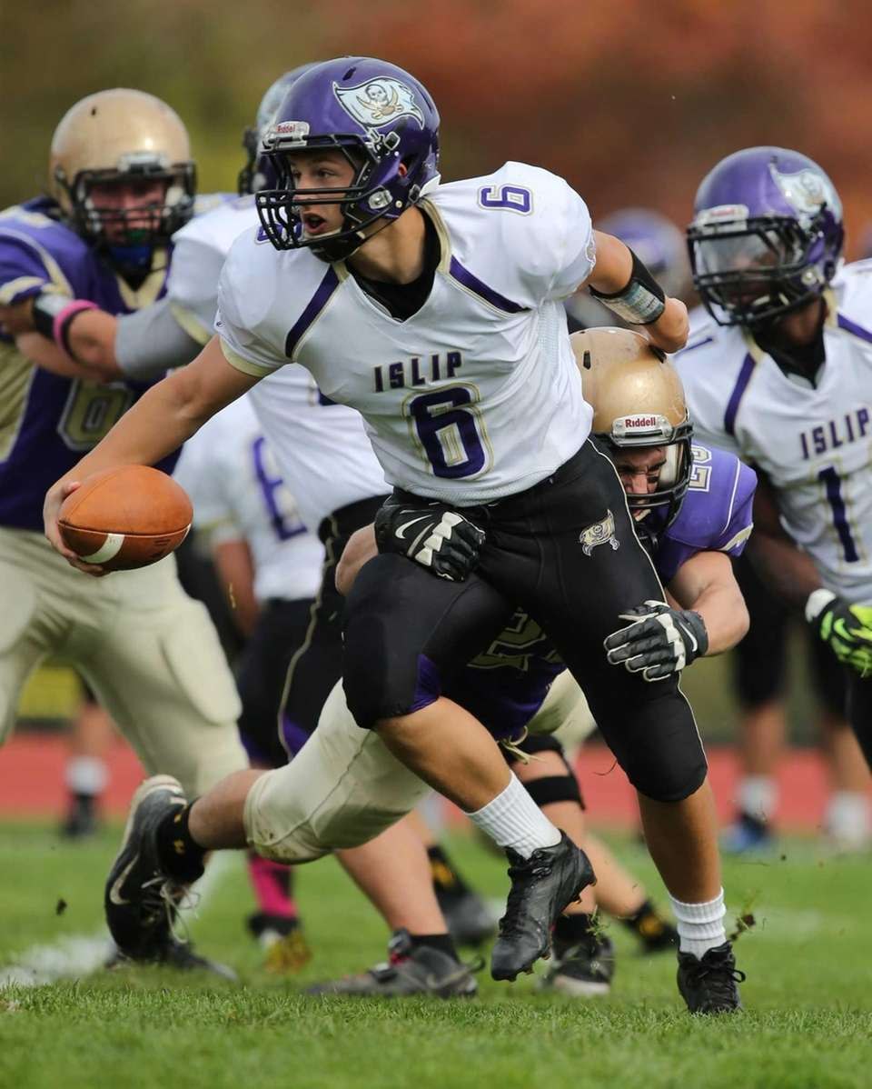 Islip quarterback Kieran Mullins (no. 6) fights off