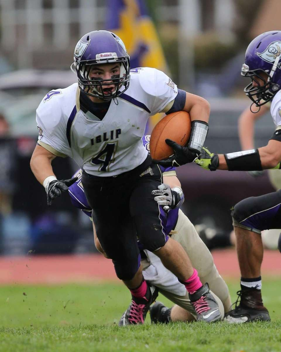 Islip's Tim Going intercepts a pass during the