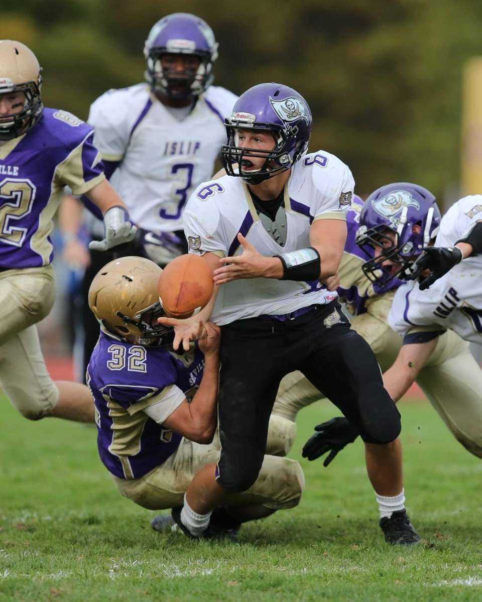Islip quarterback Kieran Mullins (no. 6) laterals before