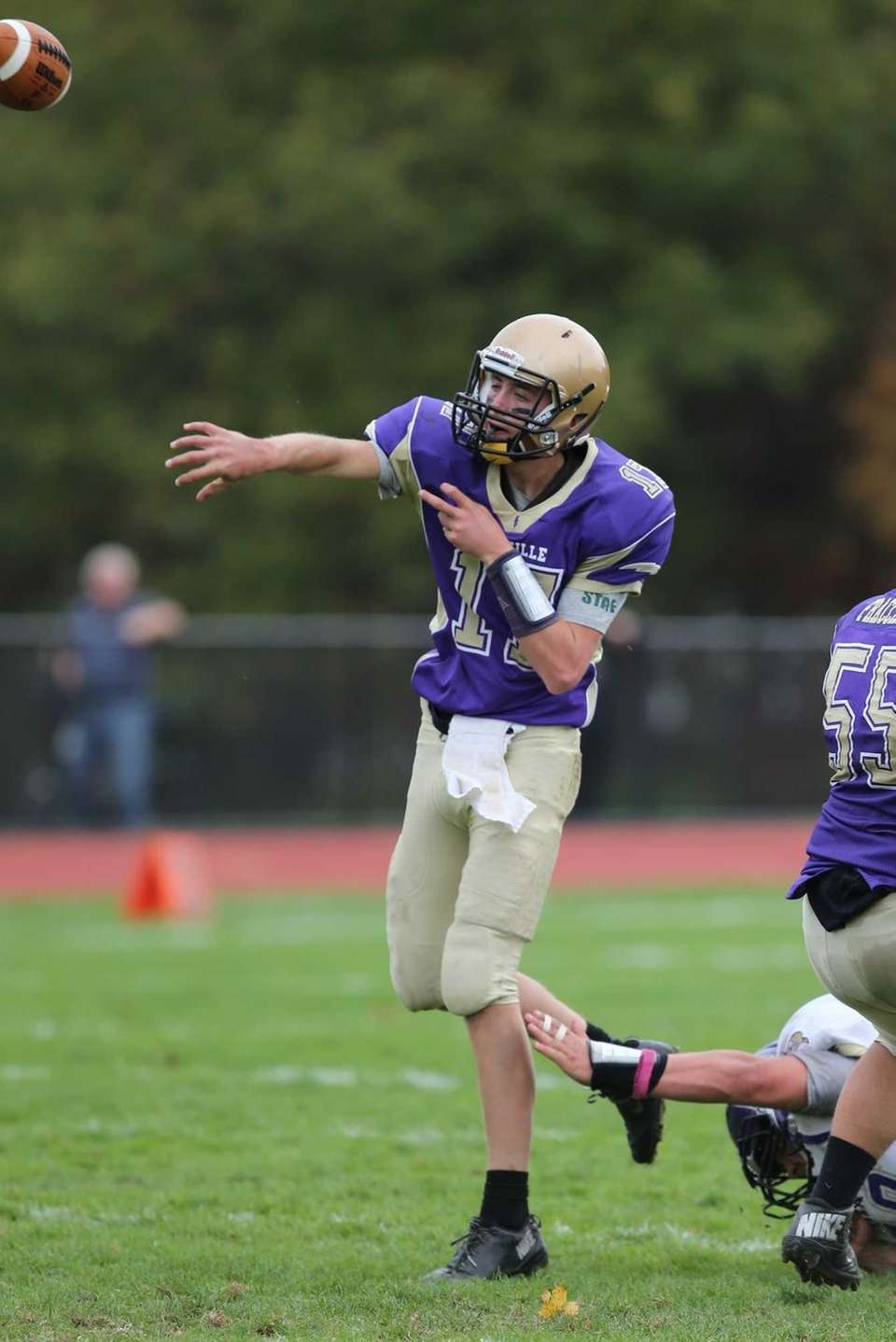 Sayville quarterback Jack Coan completes a pass during