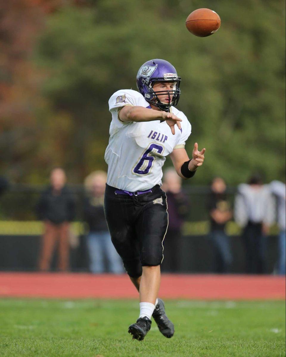 Islip quarterback Kieran Mullins completes a pass for