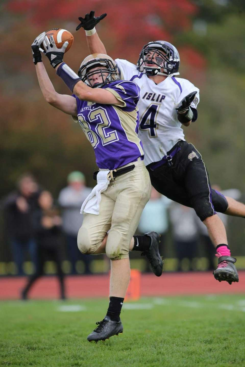 Sayville's Kevin Murphy (no. 82) catches a pass