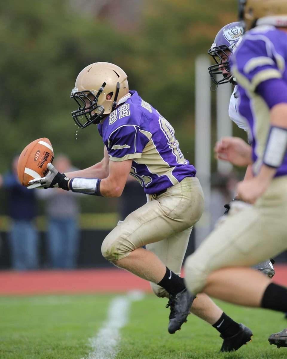 Sayville wide receiver Kevin Murphy (no. 82) makes