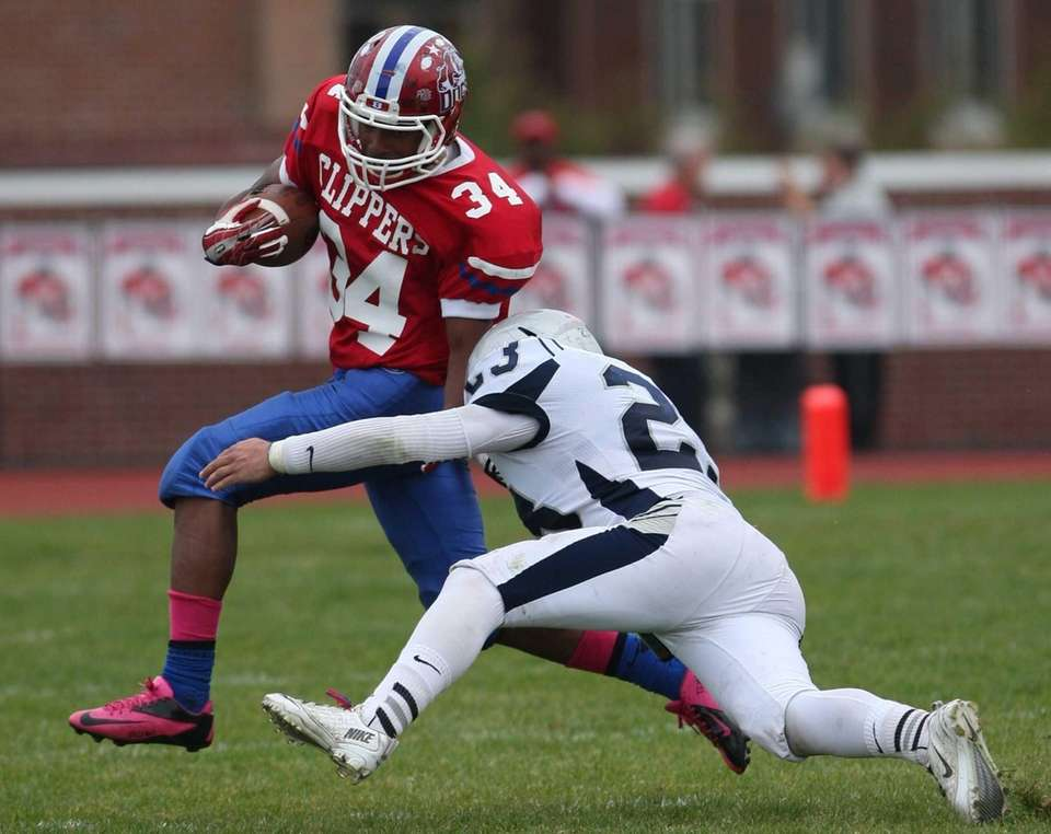 Bellport's Jabari M'Bhaso (left) tries to get past