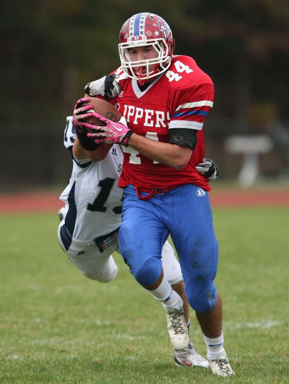 Bellport's Connor Cipp catches a pass agaisnt Eastport