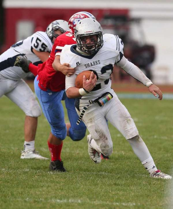 Eastport South Manor's Cole Zeller runs against Bellport.