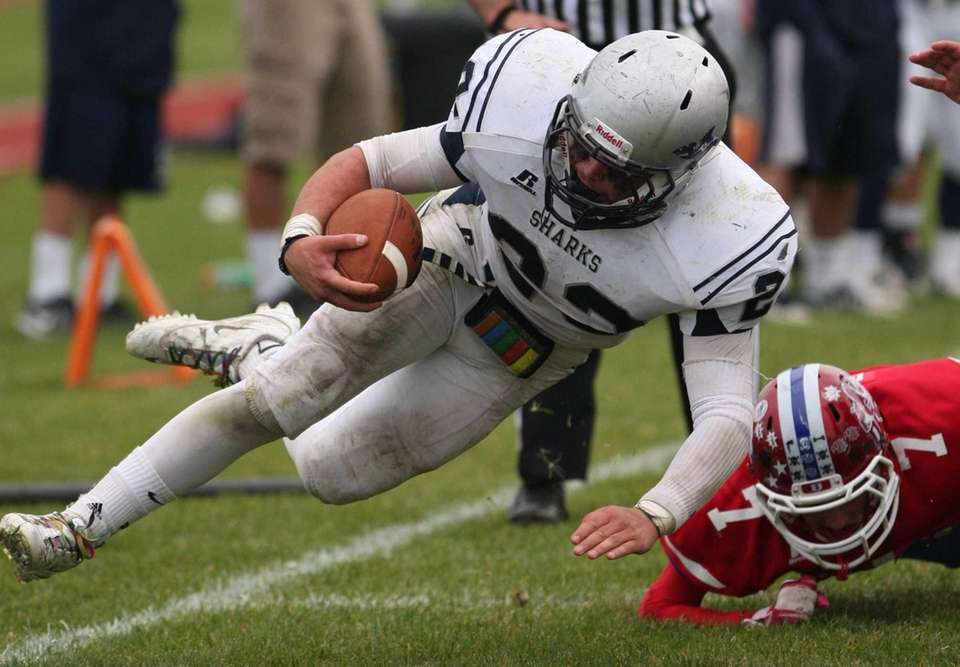 Eastport South Manor's Cole Zeller (left) gets taken