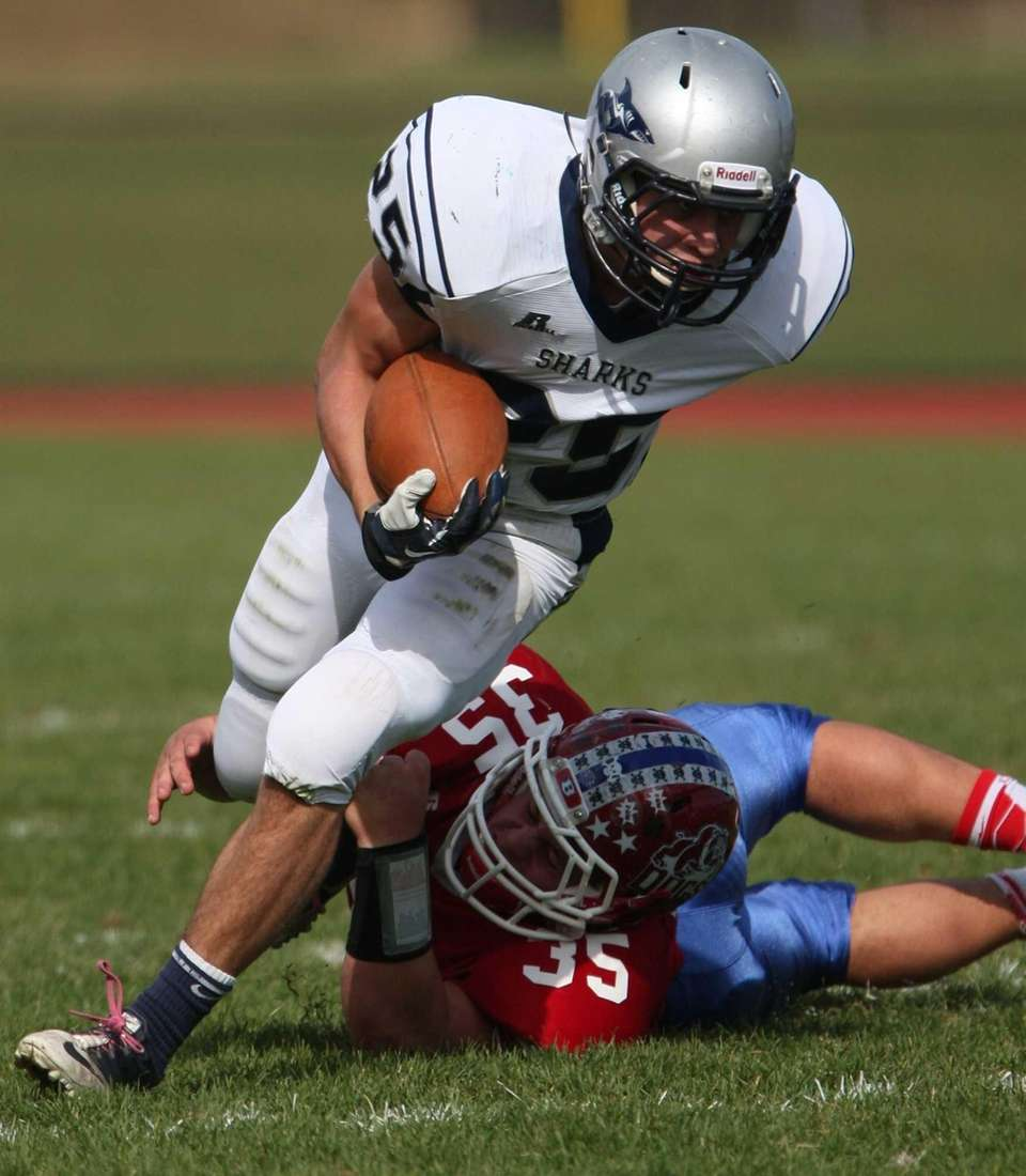 Eastport South Manor's Jake Hobie gets grabbed by