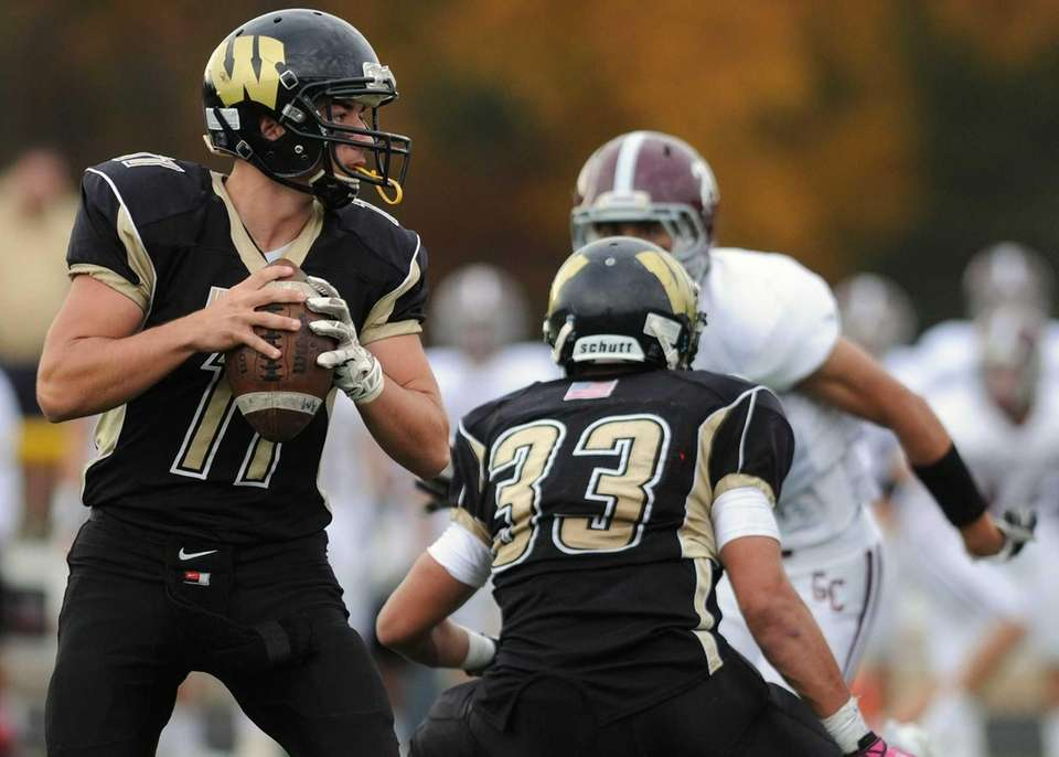 Wantagh quarterback Stephen Killard (no. 11) looks for