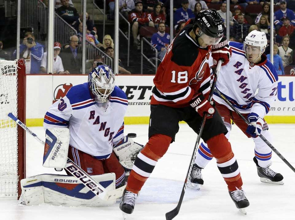 Rangers goalie Henrik Lundqvist, left, blocks a shot
