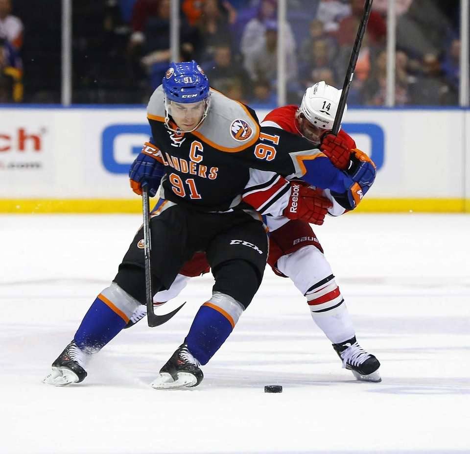 John Tavares of the Islanders tries to skate