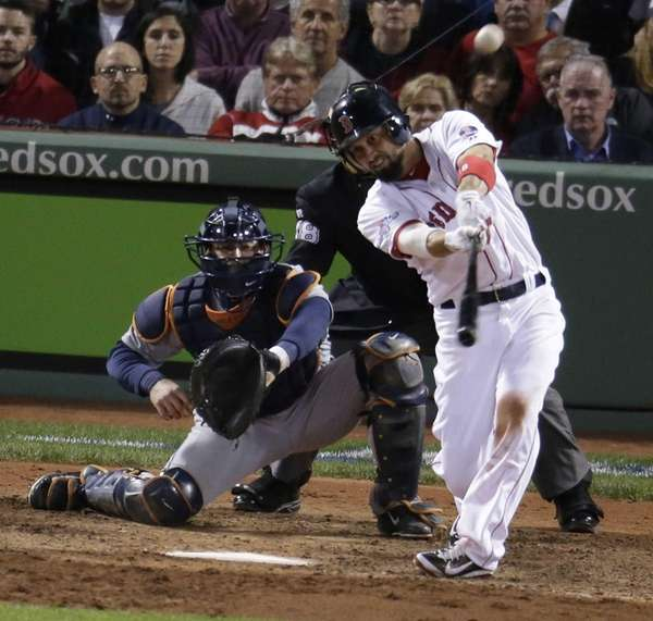 Boston Red Sox's Shane Victorino hits a grand