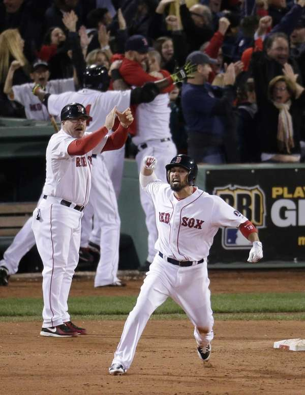 Boston Red Sox's Shane Victorino, front, celebrates his