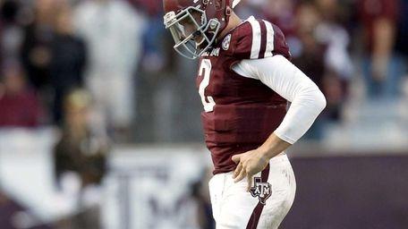 Texas A&M quarterback Johnny Manziel walks off the