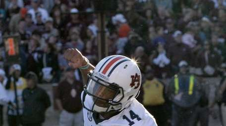 Auburn's Nick Marshall celebrates a touchdown against the