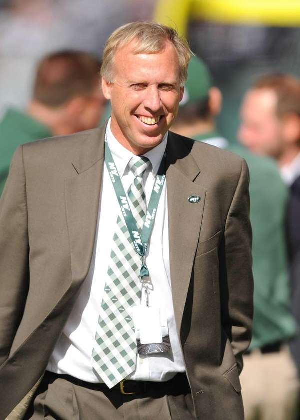 John Idzik looks on before a game against