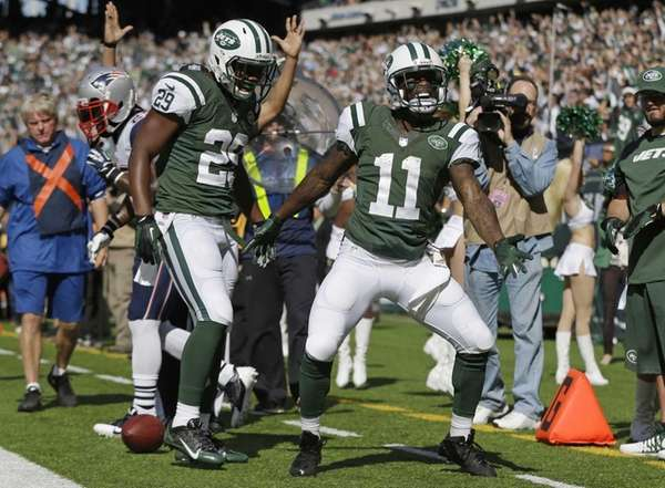Jeremy Kerley (11) and Bilal Powell (29) celebrate