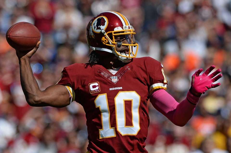 Washington Redskins quarterback Robert Griffin III passes during